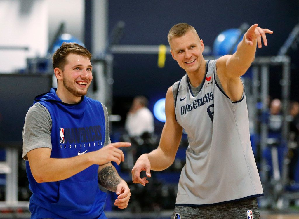 Dallas Mavericks forward Luka Doncic (77) and Dallas Mavericks forward Kristaps Porzingis (6) laugh as they compete in a three point shootout during training camp practice at the Dallas Mavericks practice facility in Dallas on Wednesday, October 2, 2019. (Vernon Bryant/The Dallas Morning News)