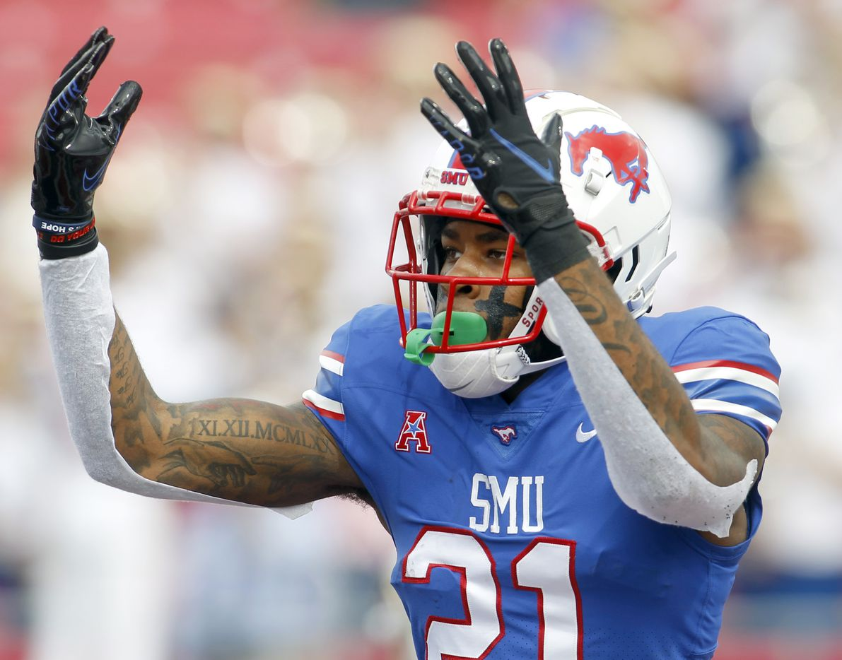 SMU receiver Reggie Roberson, Jr.  (21) gestures to the homecoming crowd following his first quarter receiving touchdown in their 41-17 win over South Florida. The two teams played their NCAA football game at SMU's Ford Stadium in Dallas on October 2, 2021. (Steve Hamm/ Special Contributor)
