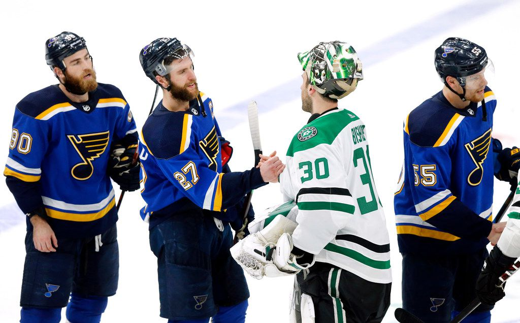 Dallas Stars goaltender Ben Bishop (30) congratulates St. Louis Blues defenseman Alex Pietrangelo (27) on their double overtime win at the Enterprise Center in St. Louis, Tuesday, May 7, 2019. The Dallas Stars lost, 2-1. The teams were playing in the Western Conference Second Round Game 7 of the 2019 NHL Stanley Cup Playoffs. (Tom Fox/The Dallas Morning News)