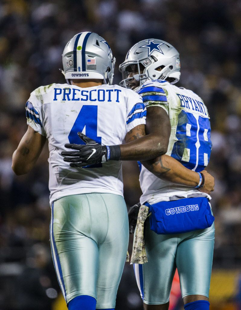 Cowboys quarterback Dak Prescott hugs Dez Bryant after they hooked up for a touchdown Sunday at Heinz Field in Pittsburgh.