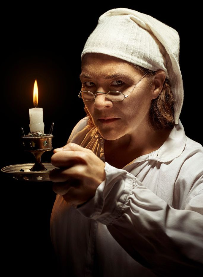 Sally Nystuen Vahle stars as Scrooge in the Dallas Theater Center's A Christmas Carol at the Wyly Theater.