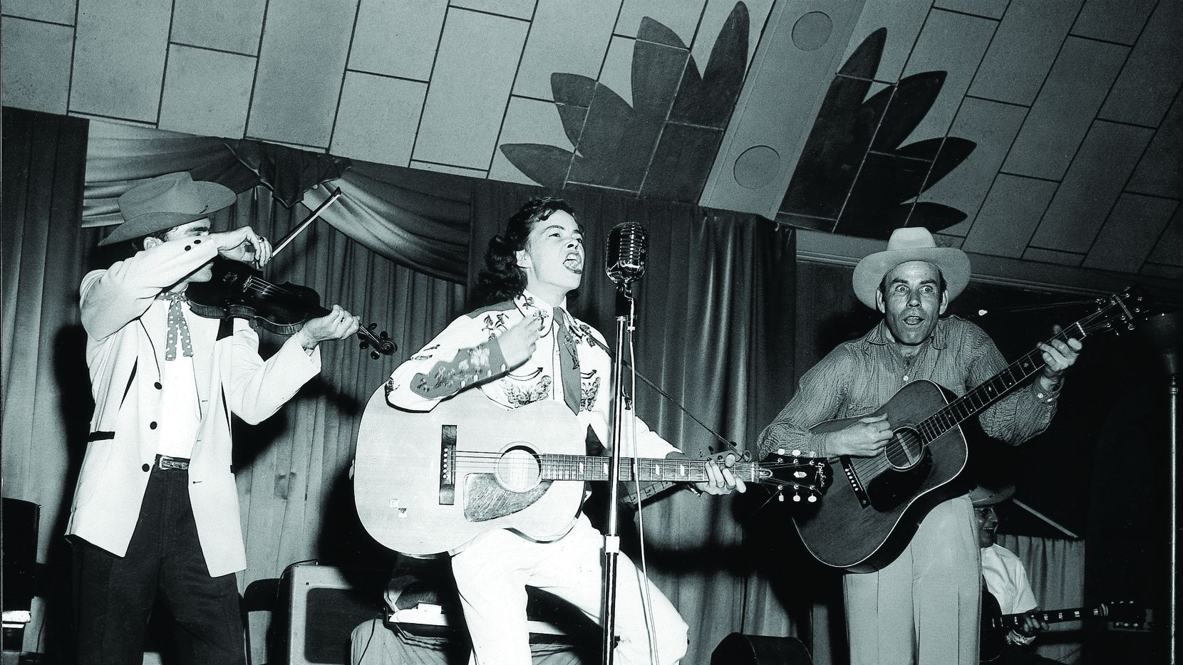 Charline Arthur, dubbed the female Elvis, performed in Tyler in the mid-1950s. Buddy Brady was on fiddle.