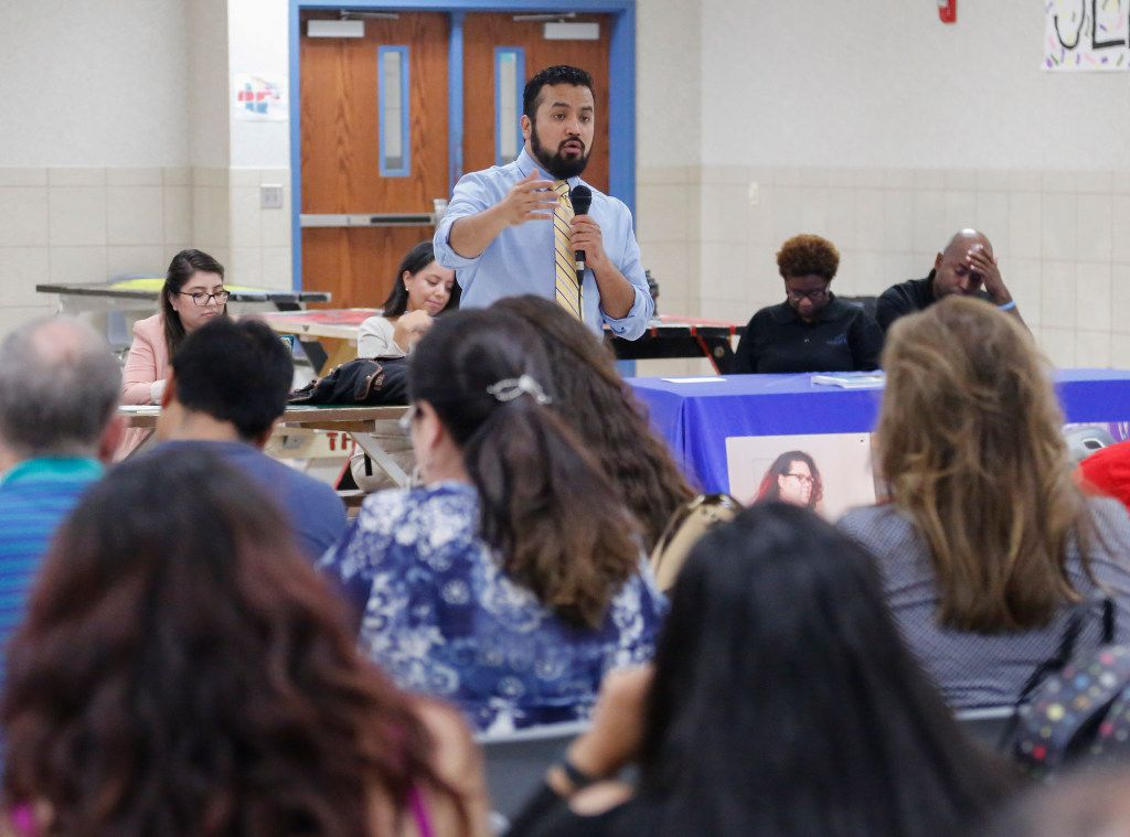 Ramiro Luna addresses a cafeteria full of immigrant parents in Mesquite on Tuesday. Issues ranged from the increased arrests of unauthorized immigrants to the end of the initiative called Deferred Action for Childhood Arrivals, or DACA.