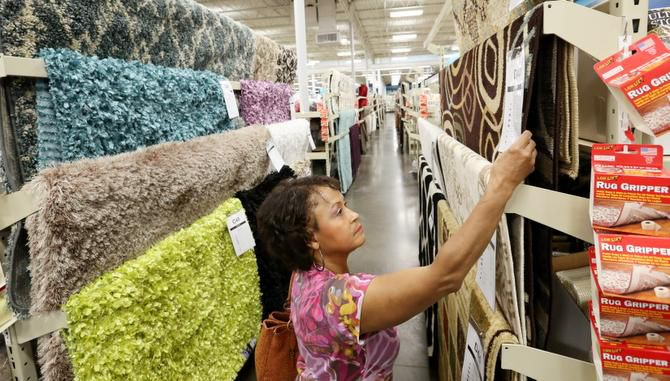 Martha Smith of Carrollton shops for rugs at the At Home store in Lewisville. At Home stores stock 50,000 items, including more than 500 area rugs. Rug prices range from $3 to $500.
