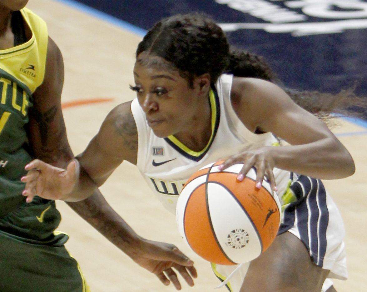 Dallas Wings guard Dana Evans (13) drives against a Seattle defender during first half action. Seattle won in overtime 100-97. The Wings hosted the Storm for their WNBA 2021season home opener at UTA's College Park Center in Arlington on May 22, 2021. (Steve Hamm/ Special Contributor)