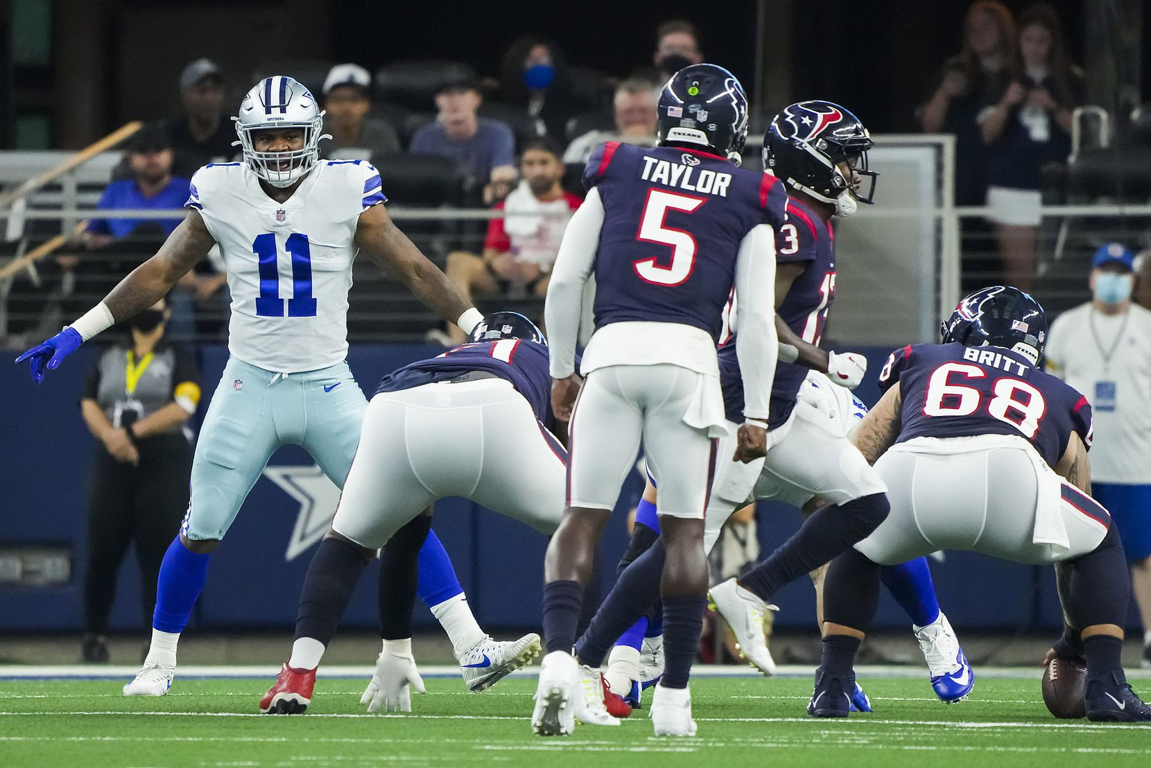 Dallas Cowboys linebacker Micah Parsons (11) lines up as Houston Texans quarterback Tyrod Taylor (5) prepares to take a snap from center Justin Britt (68) during the first half of a preseason NFL football game at AT&T Stadium on Saturday, Aug. 21, 2021, in Arlington.