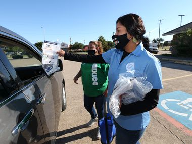 Astrid Aguiñaga of Dallas County Counts distributes census kits at the Pioneer Event Center in Grand Prairie.