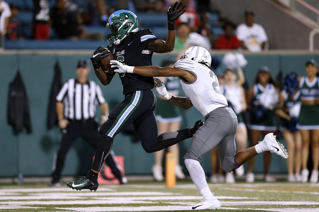 NEW ORLEANS, LA - SEPTEMBER 28:  Corey Dauphine #6 of the Tulane Green Wave scores a touchdown as T.J. Carter #2 of the Memphis Tigers defends during the second half at Yulman Stadium on September 28, 2018 in New Orleans, Louisiana.  (Photo by Jonathan Bachman/Getty Images)