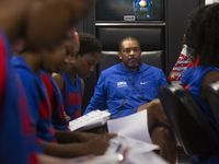 Travis Mays (center), head coach of SMU women's basketball, watches his team as they take notes during a film session reviewing the No. 1 ranked University of Connecticut Huskies. (Lynda M. Gonzalez/The Dallas Morning News)