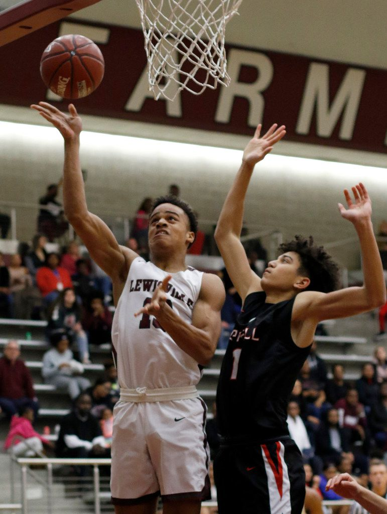 Lewisville's Tylan Dunn (13) scores over the defense of Coppell's Anthony Black (1) during first quarter action. The two teams played their District 6-6A boys basketball game at Lewisville High School in Lewisville on January 28, 2020. (Steve Hamm/ Special Contributor)