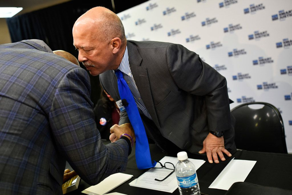 John Creuzot talks with Paul Quinn College President Michael Sorrell before the start of a criminal justice forum hosted by the American Civil Liberties Union of Texas at Paul Quinn College in Dallas on Saturday.