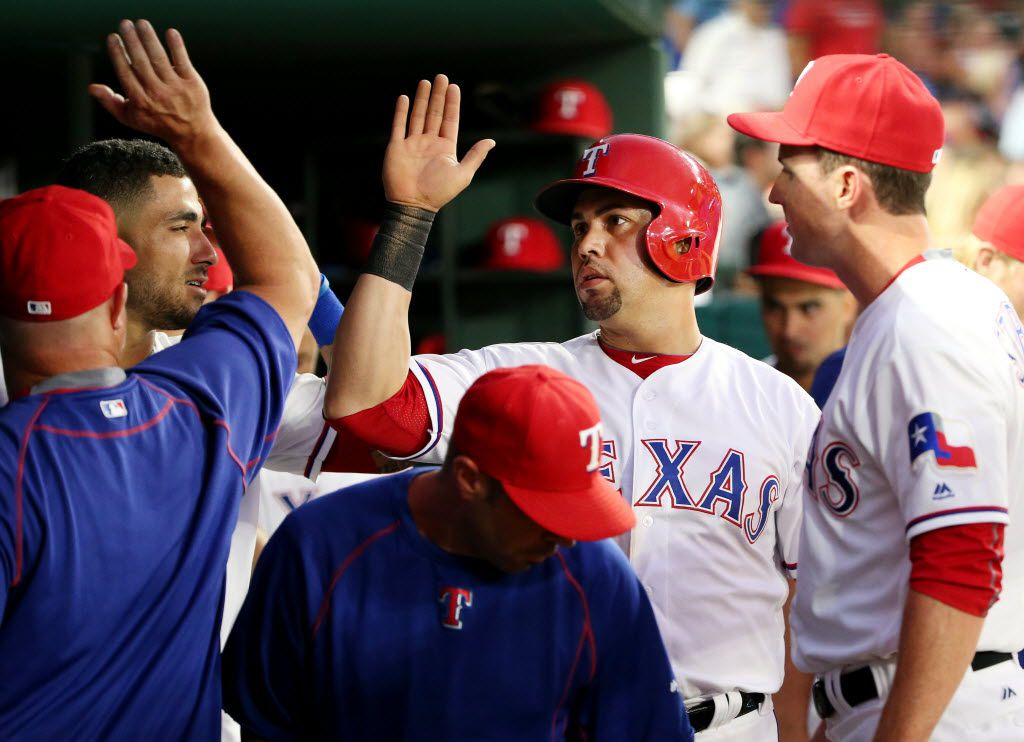 Rangers right fielder Carlos Beltran (36) is congratulated by teammates after he scored on an RBI single by shortstop Elvis Andrus (1) to make the score 1-2 in the fourth inning during a Major League Baseball game between the Oakland Athletics and the Texas Rangers at Globe Life Park in Arlington, Texas Monday August 15, 2016.
