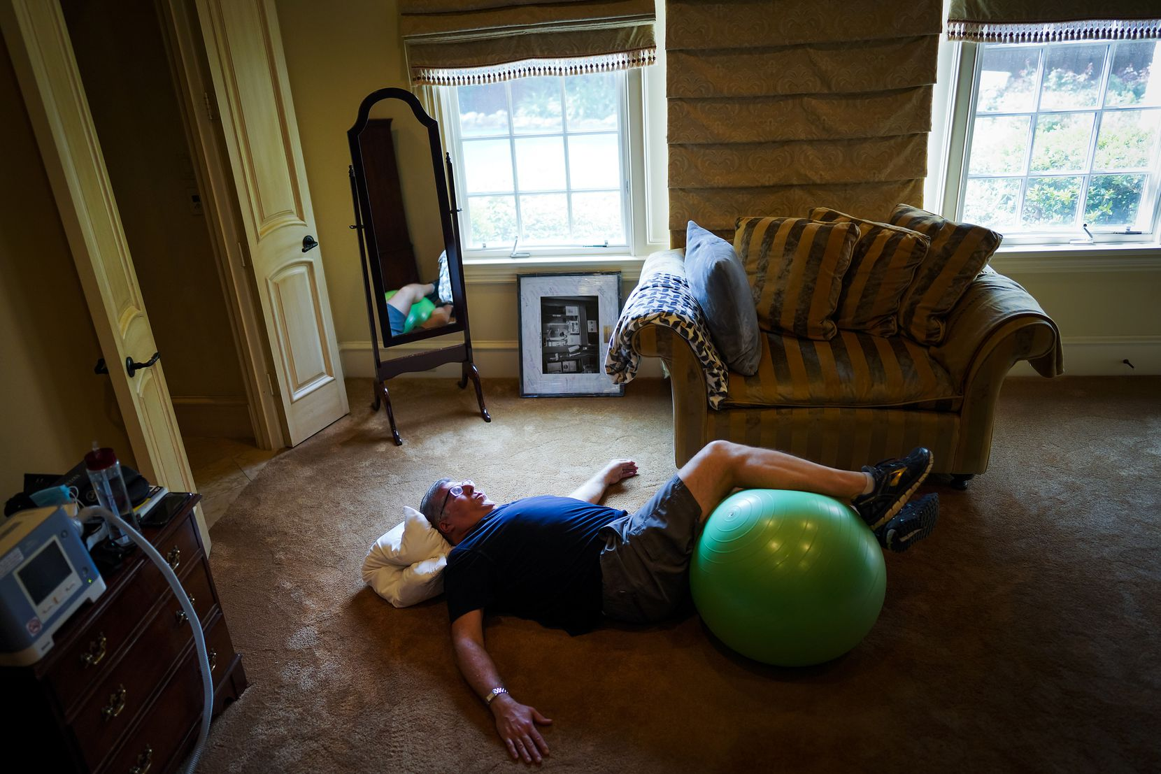Michael Hoffman works out at home on the days when he doesn't have outpatient rehab at UT Southwestern Medical Center.