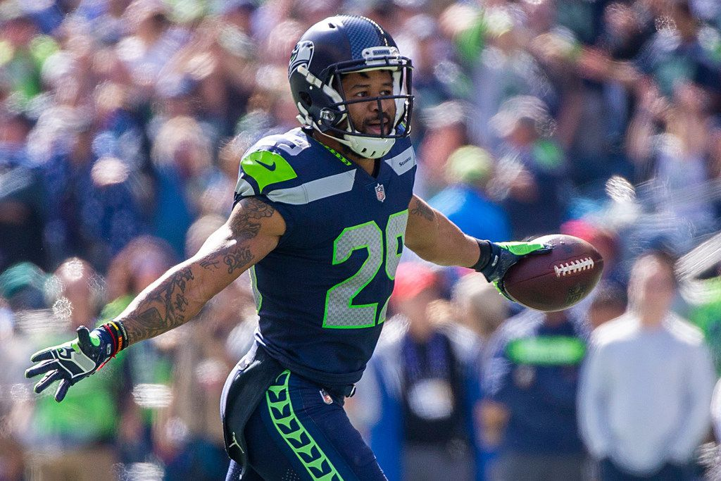 Seattle Seahawks defensive back Earl Thomas (29) celebrates after intercepting a pass off the hands of Dallas Cowboys wide receiver Michael Gallup (13) during the first half of an NFL football game at CenturyLink Field on Sunday, Sept. 23, 2018, in Seattle. (Smiley N. Pool/The Dallas Morning News)