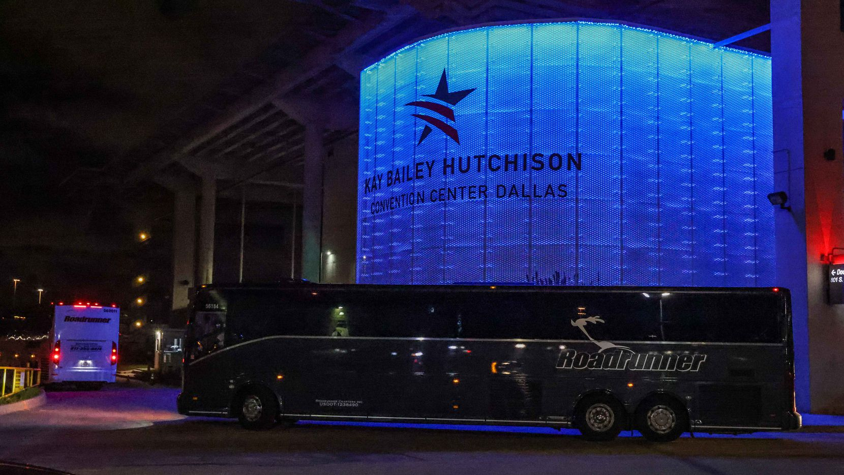 Four charter buses arrive at the Kay Bailey Hutchison Convention Center in Dallas on Wednesday, March 17, 2021, escorted by Federal Protective Service Police. The U.S. Department of Health and Human Services confirmed Tuesday that the convention center will serve as an emergency intake site to hold teens who have arrived at the U.S.-Mexico border starting Wednesday to decrease overcrowding at Customs and Border Protection facilities.