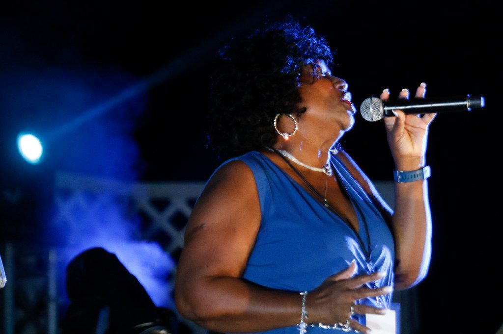 Martha Burks belts performed with 40 Fingers 4 Pianos on opening night of the Riverfront Jazz Festival in  2017.