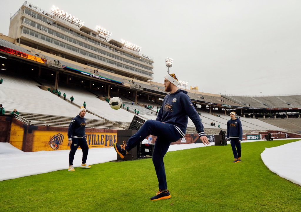 Nashville Predators defenseman Mattias Ekholm (14) kicks a soccer ball with teammates as they get acclimated to the chilly weather before the NHL Winter Classic hockey game at the Cotton Bowl in Dallas, Wednesday, January 1, 2019. (Tom Fox/The Dallas Morning News)