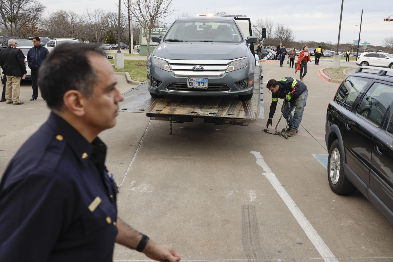 A blue Ford Fusion registered to Dallas City Council member Kevin Felder's address is towed away from the Park In the Woods Recreation Center in Dallas, where Felder was taking part in a Dallas City Council meeting on Wednesday, Feb. 13, 2019.