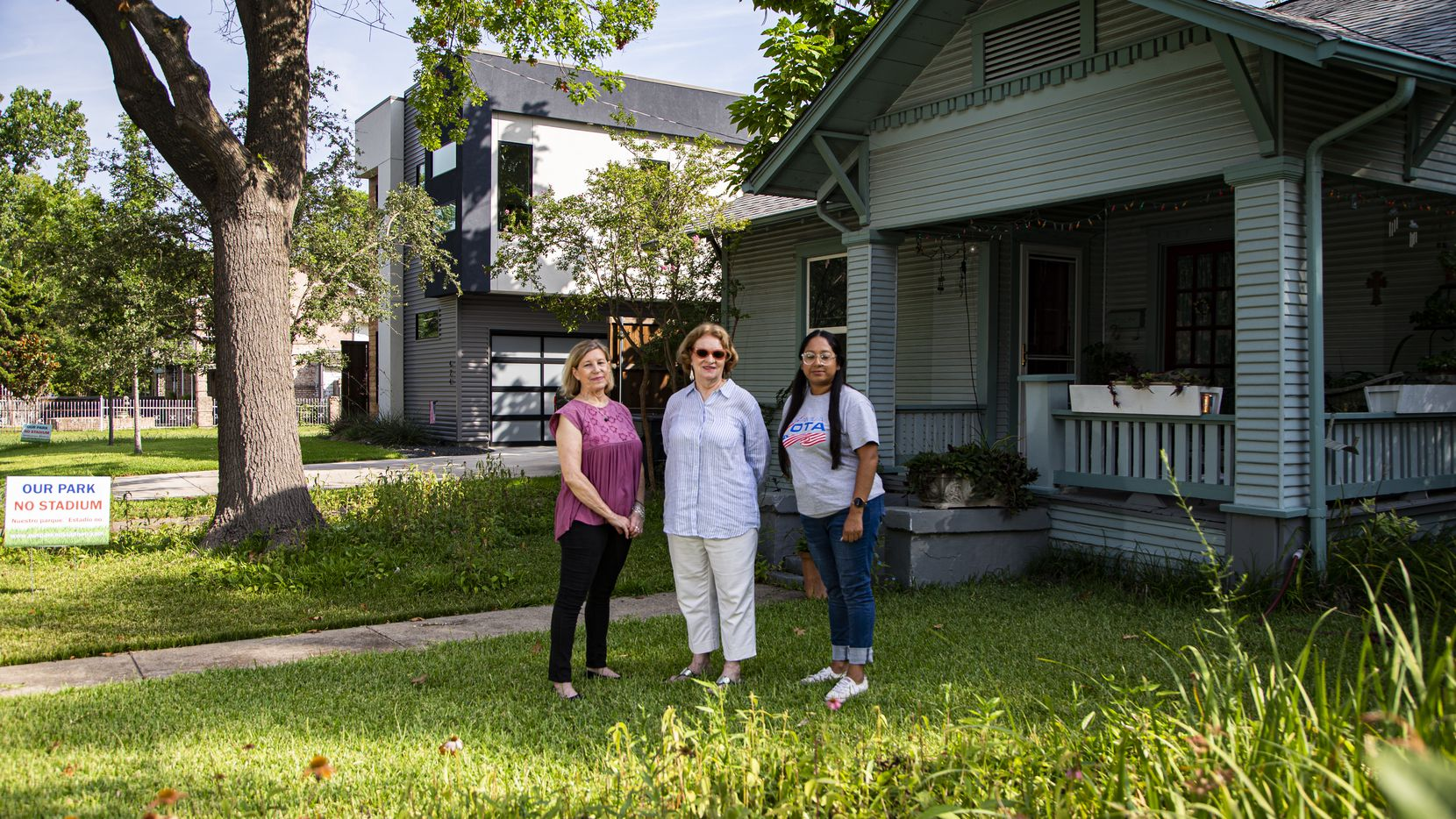 Jeanne Chvosta (from left), Karen Roberts and Sarah Mendoza in front of Roberts' home in the Mount Auburn neighborhood. High property taxes, especially due to new construction such as the house next door to Roberts' home, threaten to push longtime residents out of the area.