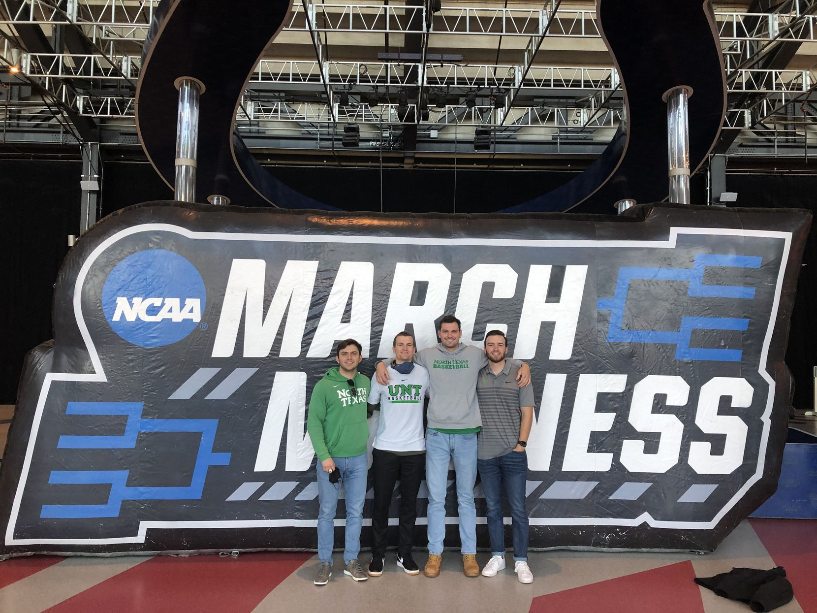 DJ Draper (middle left) stands alongside his friends from North Texas at Lucas Oil Stadium in Indianapolis.