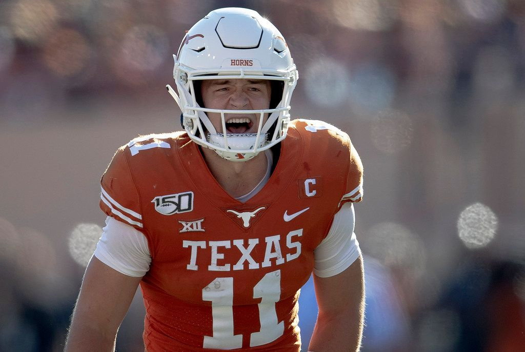 Texas quarterback Sam Ehlinger (11) shouts to teammates against Kansas State during an NCAA college football game Saturday, Nov. 9, 2019, in Austin, Texas. (Nick Wagner/Austin American-Statesman via AP)