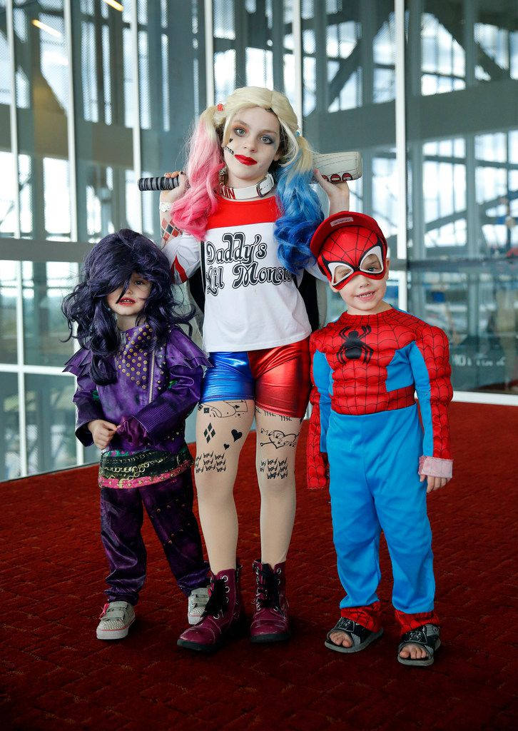 Dressed as Harley Quinn of Suicide Squad, Emily Pearson of Euless (center) poses with her sister Hannah Pearson, left, (Mal of the movie Descendants) and brother Nathan Pearson (Spider-man).
