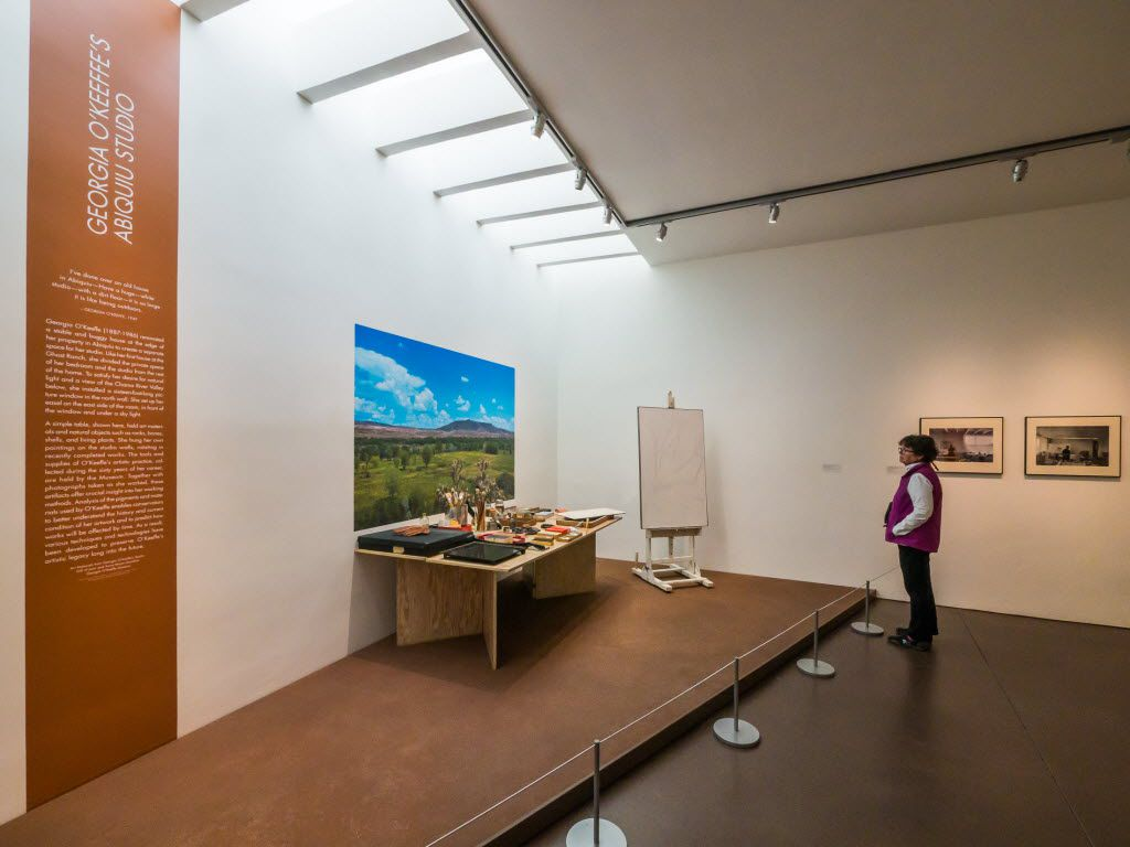 A visitor examines a replica of the artist's Abiquiu studio at the Georgia O'Keeffe Museum in downtown Santa Fe