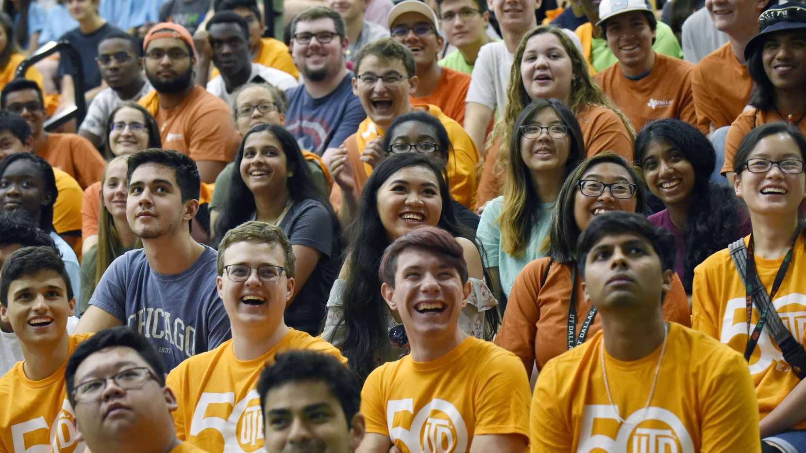 New students react with laughter as they watch a video promoting UTD during a new student convocation celebrating the University of Texas at Dallas' 50th anniversary, Sunday Aug. 18, 2019 in Richardson.