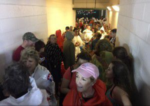 Fans at Globe Life Park for the Academy of Country Music's Party for a Cause festival were taken into tunnels as strong wind and rain approached. (Andy Jacobsohn/Staff Photographer)