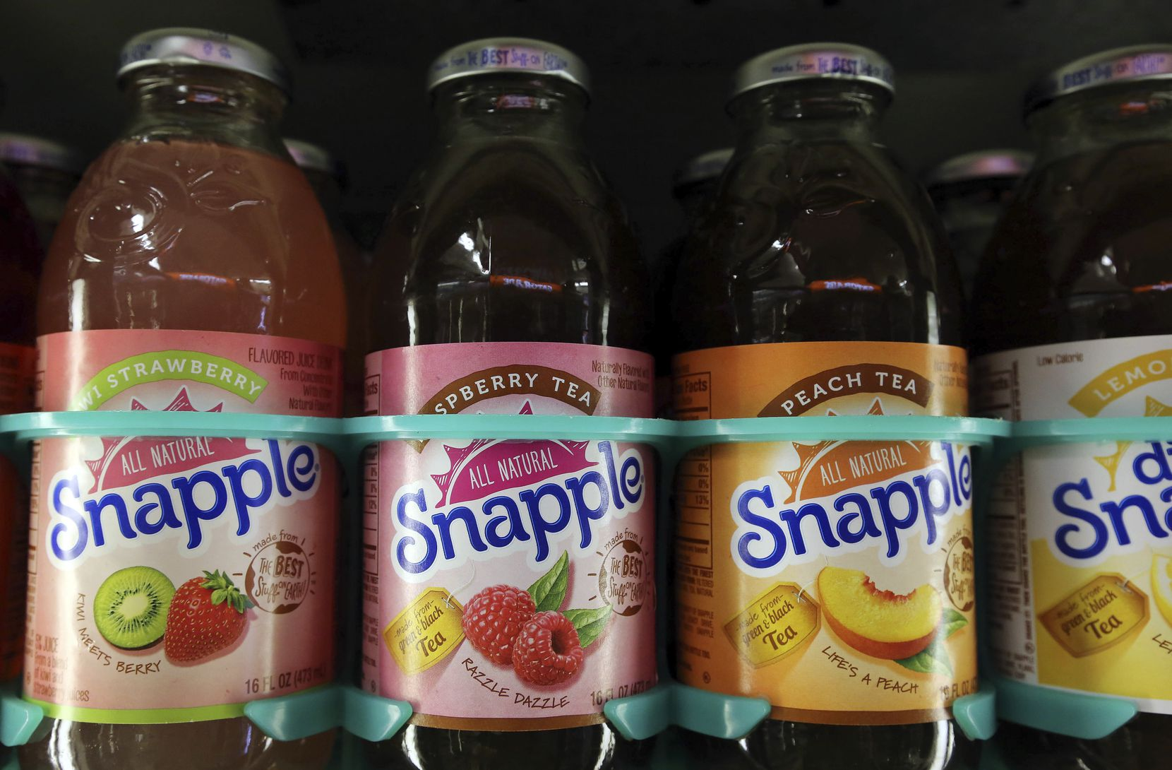 Bottles of Snapple in a cooler at Quality Cash Market in Concord, N.H. In a deal announced Monday, Jan. 29, 2018, Keurig will buy Dr. Pepper Snapple Group, creating a beverage giant with about $11 billion in annual sales.
