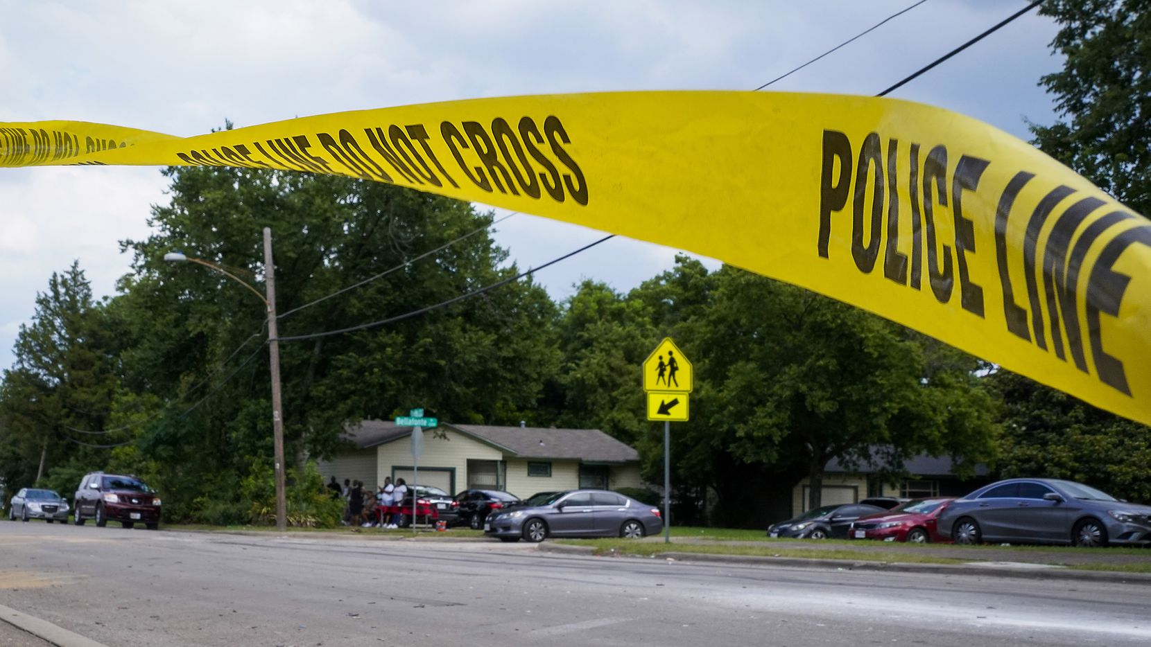 Police tape flutters at the scene scene of a shooting in the 8300 block of Towns St.  in Hamilton Park on July 5, 2021, in Dallas. Five people were shot as a party wound down about 11:15 p.m. on July Fourth. Three of those have died.