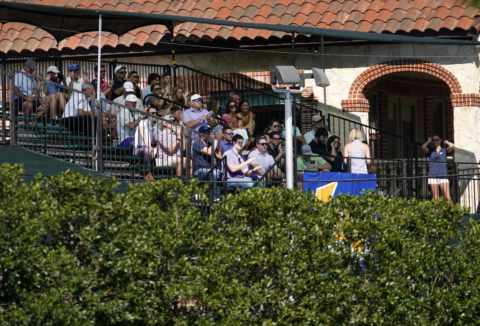 Golf fans fill bleachers built outside the 16th tee box as they applaud PGA Tour golfer Jordan Spieth during the opening round of the Charles Schwab Challenge at the Colonial Country Club in Fort Worth, Thursday, June 11, 2020.  Fans were not allowed to attend The Challenge, the first tour event since the COVID-19 pandemic began.