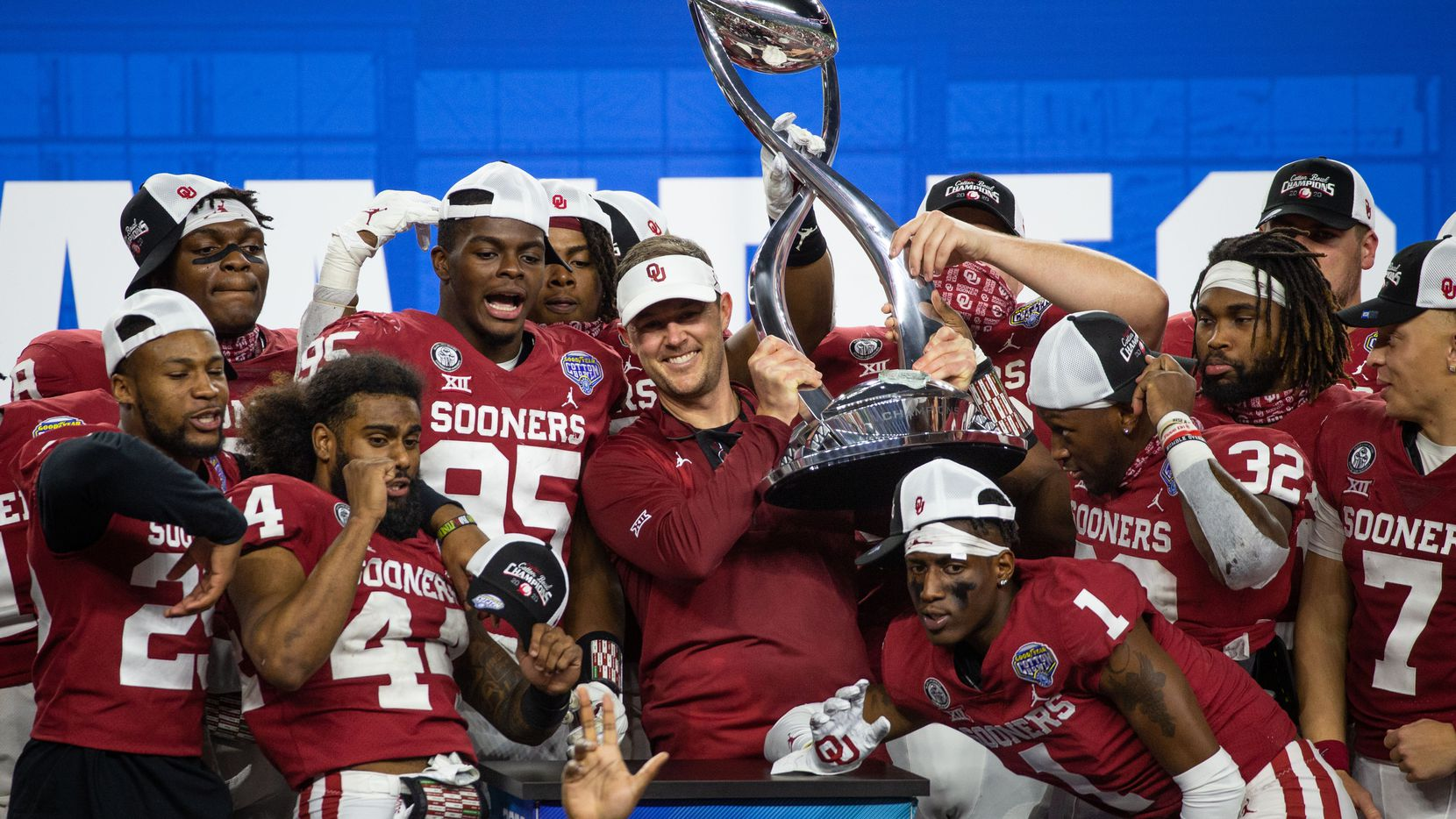 Oklahoma head coach Lincoln Riley holds up the Cotton Bowl champions' trophy and celebrates with his team following the Cotton Bowl Classic against Florida on Thursday, Dec. 30, 2020.