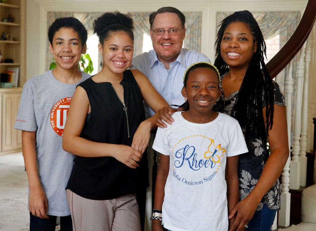 Haley Taylor Schlitz, 16, (second from left) will attend SMU's Dedman School of Law in the fall at just 16 years old.  She is photographed with (from left) her brother Ian Taylor Schlitz, father William Schlitz, sister Hana Taylor Schlitz and mother Dr. Myiesha Taylor at their family home, Saturday, March 23, 2019.