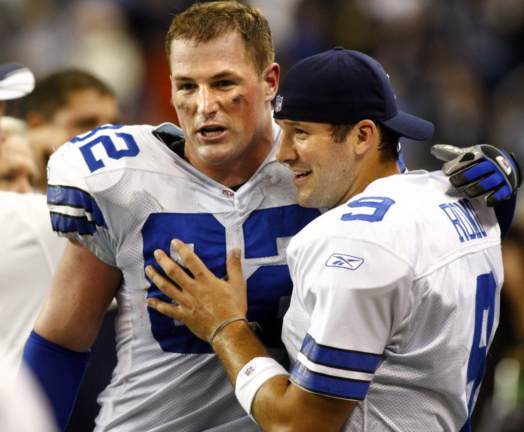 Dallas Cowboys tight end Jason Witten (left) and quarterback Tony Romo (9) hug on the bench during second  half NFL football action between the Dallas Cowboys and the Detroit Lions at Ford Field in Detroit, MI on Sunday, December 9, 2007. Dallas won the game 28-27.
