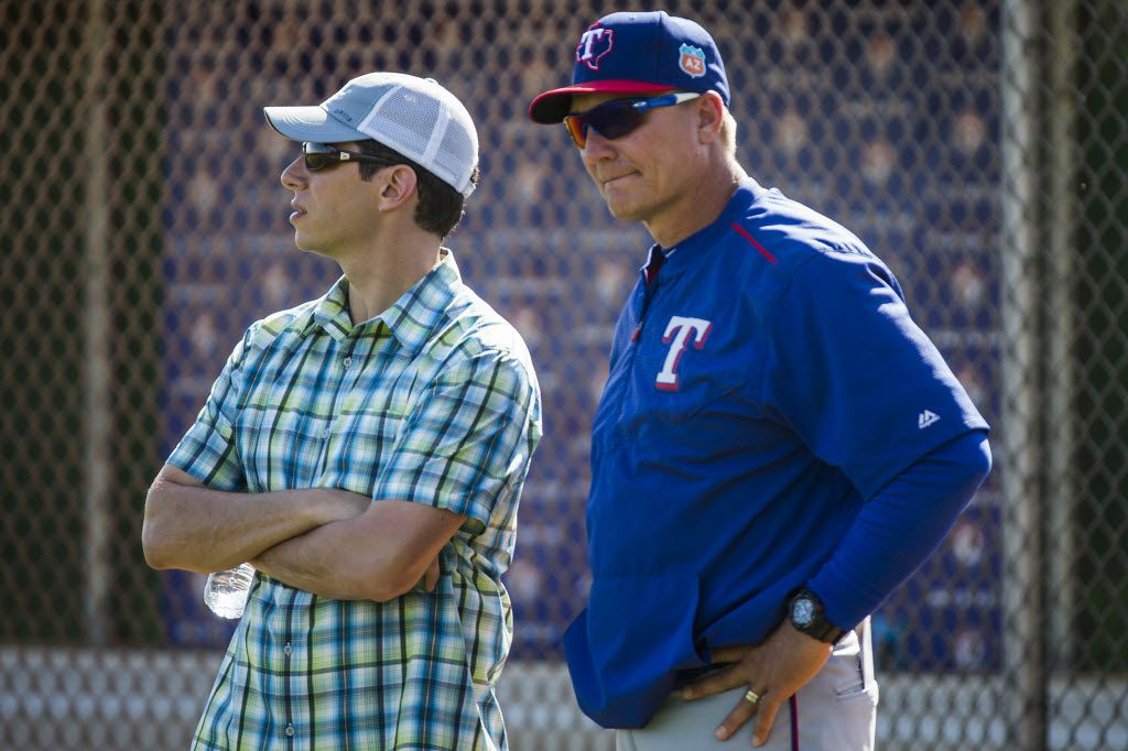 Texas Rangers General Manager Jon Daniels  watches a spring workout with manager Jeff Banister at the team's training facility on Tuesday, March 1, 2016, in Surprise, Ariz. (Smiley N. Pool/The Dallas Morning News)