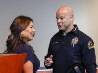 Dallas Police Chief Eddie García speaks with Judge Sara Martinez, Precinct 5 Justice of the Peace, after a press conference at Dallas Police Headquarters on Thursday, Oct. 21, 2021, in Dallas.