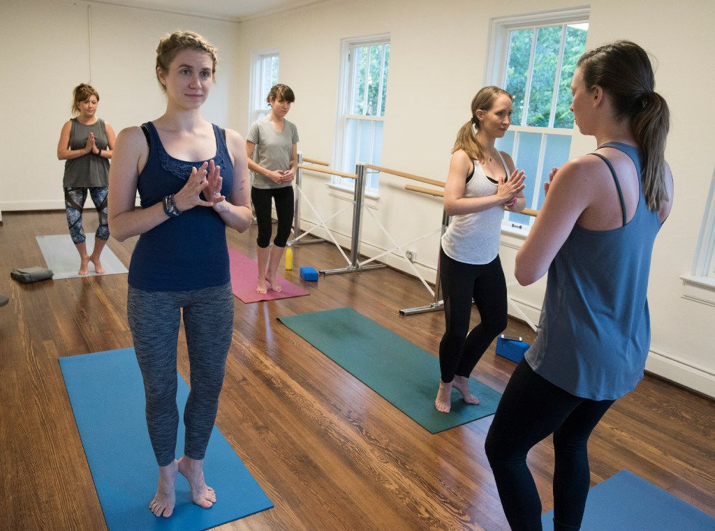 Emily Hylden (left)  and others participate in a Pilates class led by Megan Shuffle Shepherd at Arts Mission Oak Cliff.
