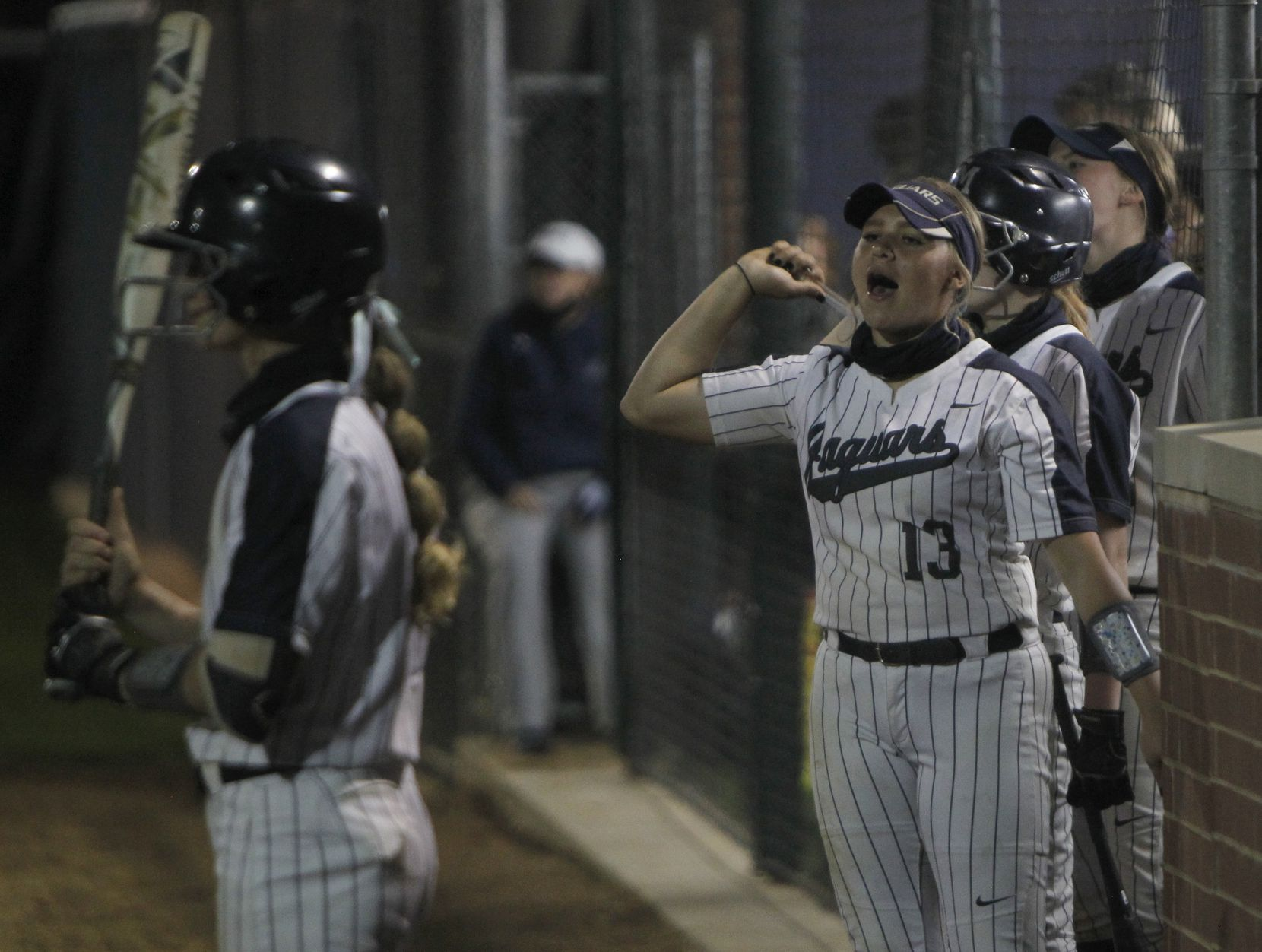 Flower Mound pitcher Karson Hassan (13) delivers vocal support to teammates from the dugout during the bottom of the 2nd inning of play against Plano. Flower Mound won 13-2. The two teams played their District 6-6A softball game at Flower Mound High School in Flower Mound on March 23, 2021. (Steve Hamm/ Special Contributor)