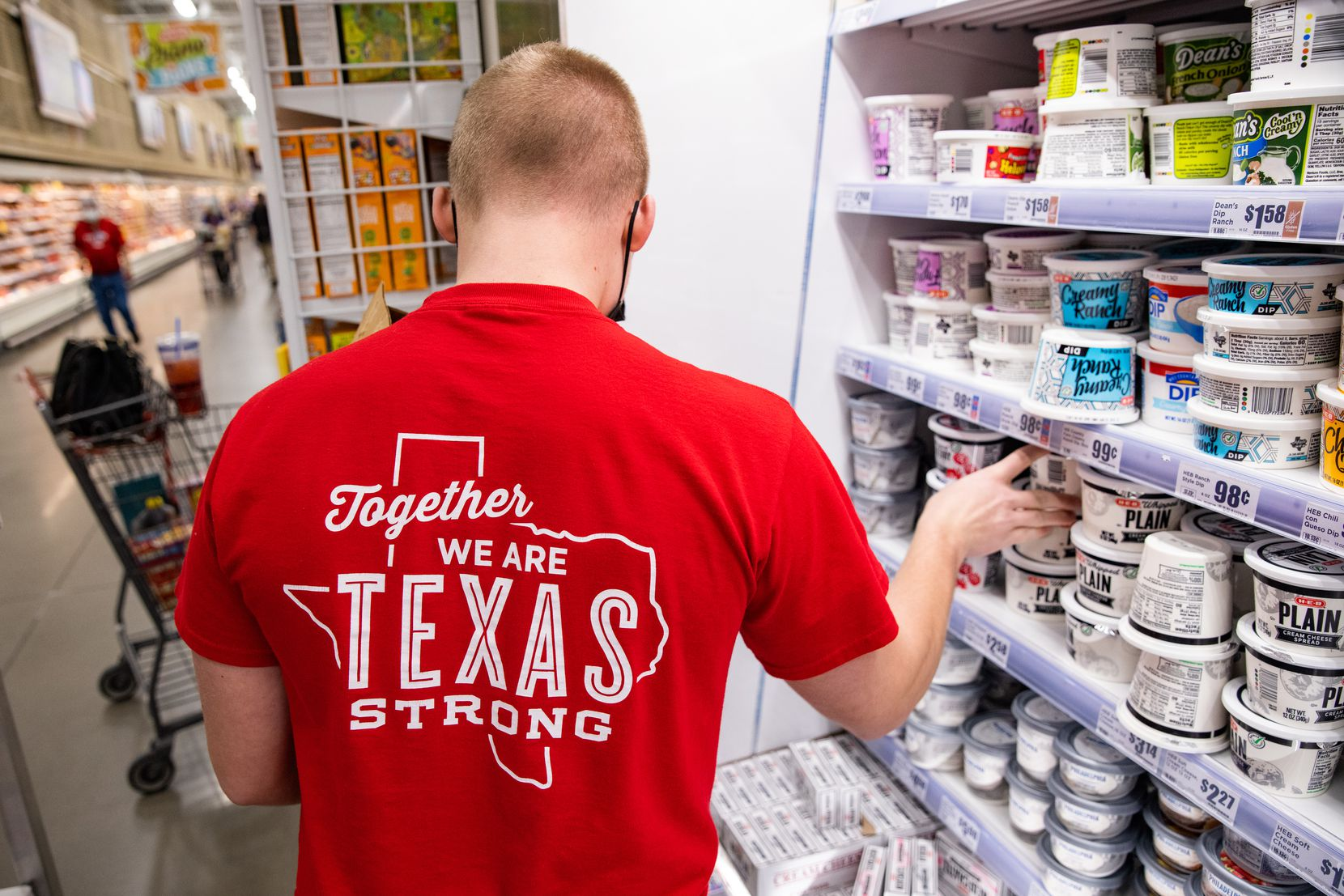 Tyler Land restocks the dairy section at the H-E-B in Hudson Oaks.