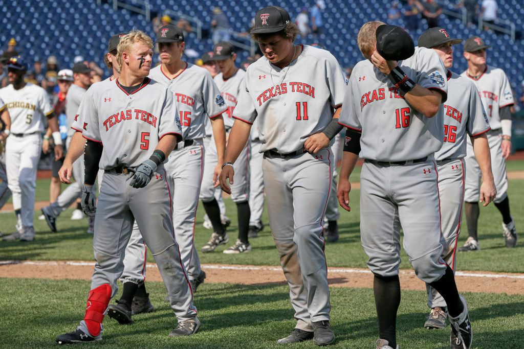 Texas Tech players walk off the field following their loss to Michigan in an NCAA College World Series baseball elimination game in Omaha, Neb., Friday, June 21, 2019. (AP Photo/Nati Harnik)