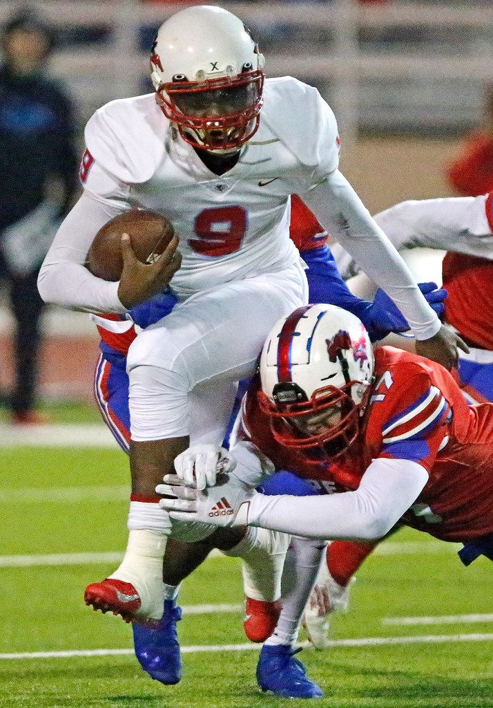 Skyline High School quarterback Darryl Richardson (9) is tackled by J.J. Pearce High School linebacker Nick Strong (17) during the first half as J.J. Pearce High School hosted Skyline High School at Eagle/Mustang Stadium in Richardson on Friday night, November 8, 2019. (Stewart F. House/Special Contributor)