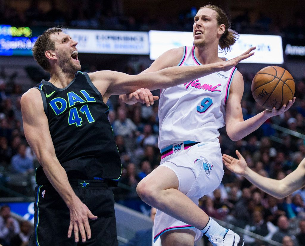 Dallas Mavericks forward Dirk Nowitzki (41) tries to block a shot by Miami Heat center Kelly Olynyk (9) during the third quarter of an NBA game between the Dallas Mavericks and the Miami Heat on Monday, January 29, 2018 at American Airlines Center in Dallas. (Ashley Landis/The Dallas Morning News)