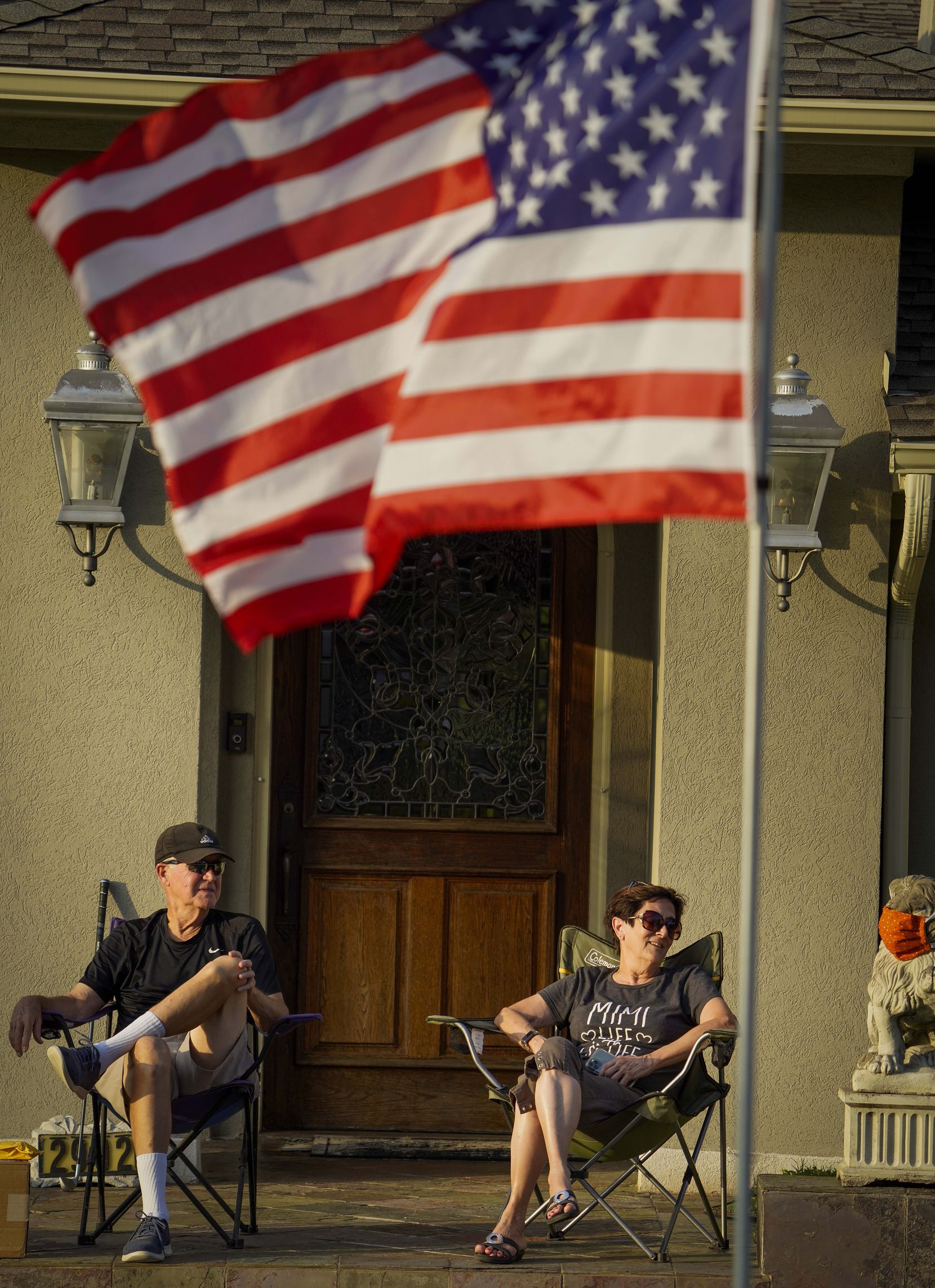 Kirk and Denice Lipscomb watch from their driveway as Cameron Havens sings from the back of a pickup truck during a 'Drive By Concert' through the Canyon Creek subdivision on Thursday, July 2, 2020, in Richardson.