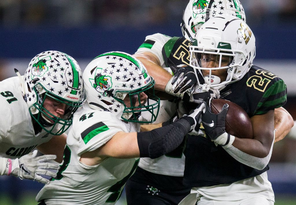 DeSoto running back  Jyison Brown (22) is tackled by Southlake Carroll defenders during the third quarter of a Class 6A Division I area-round high school football playoff game between Southlake Carroll and DeSoto on Friday, November 22, 2019 at AT&T Stadium in Arlington. (Ashley Landis/The Dallas Morning News)
