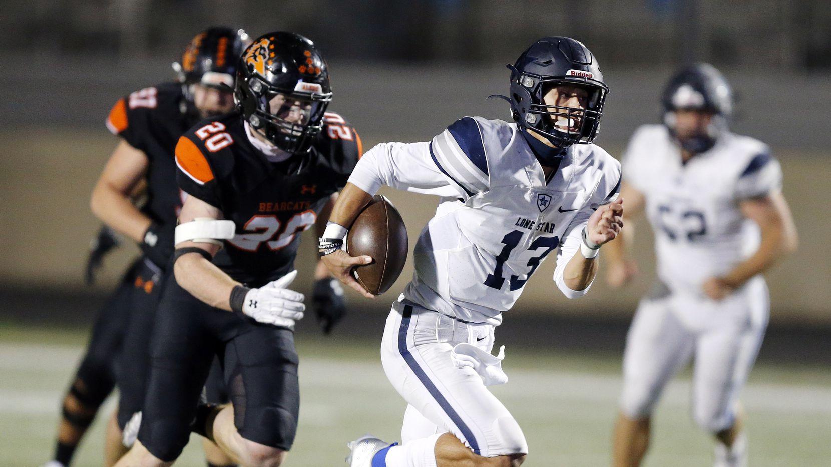 Frisco Lone Star quarterback Garret Rangel breaks away for a big run in the fourth quarter against Aledo's Sam Forman at Bearcat Stadium in Aledo, Texas, Friday, October 2 2020. Aledo won, 34-32.