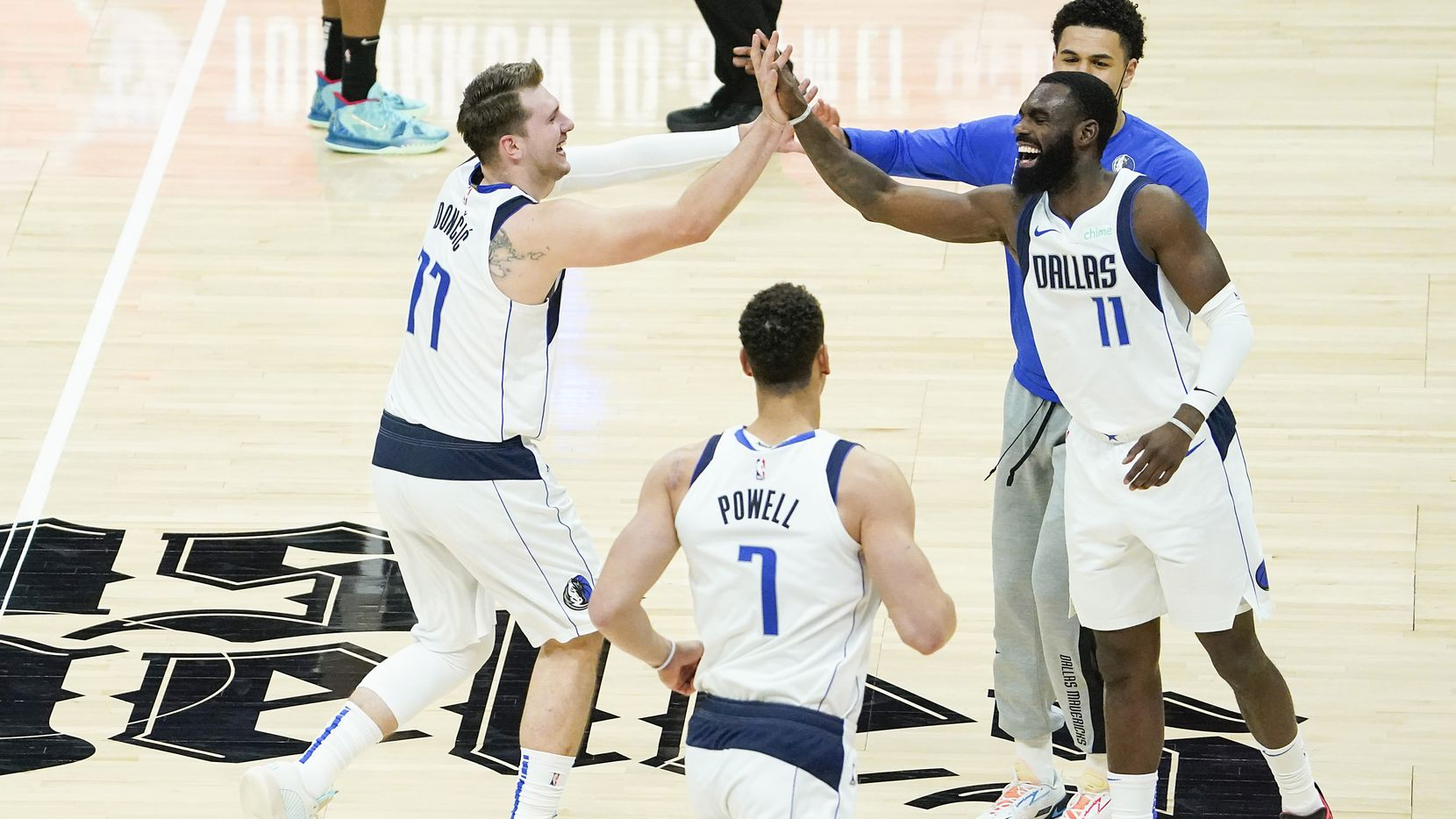 Dallas Mavericks guard Luka Doncic (77) celebrates with forward Tim Hardaway Jr. (11) after scoring during the third quarter of an NBA playoff basketball game against the LA Clippers at the Staples Center on Wednesday, June 2, 2021, in Los Angeles.