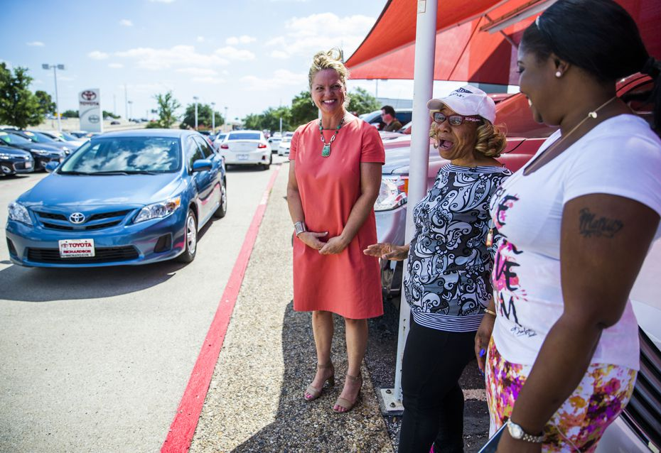 Pamala Burch (center) shows her excitement with Michelle Corson (left) of On The Road Lending and Kiyundra Gulley (right), president of the Oak Cliff Chamber of Commerce, after she received a gently used Toyota Corolla on Thursday  at Toyota of Richardson. The car purchase was facilitated by On The Road Lending, a nonprofit that helps provide cars for low-income residents.