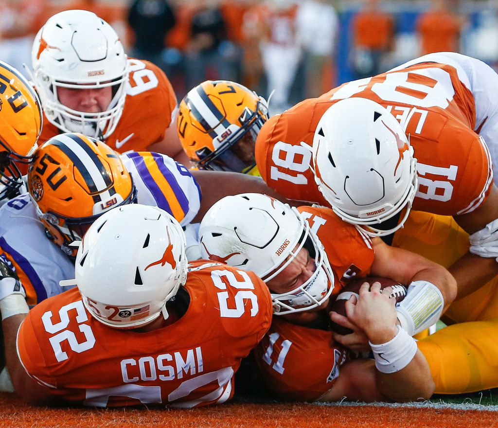 Texas Longhorns quarterback Sam Ehlinger (11) fails to score as he is brought down by LSU Tigers defense during the first quarter of a college football game between the University of Texas and Louisiana State University on Saturday, Sept. 7, 2019 at Darrell Royal Memorial Stadium in Austin, Texas. (Ryan Michalesko/The Dallas Morning News)