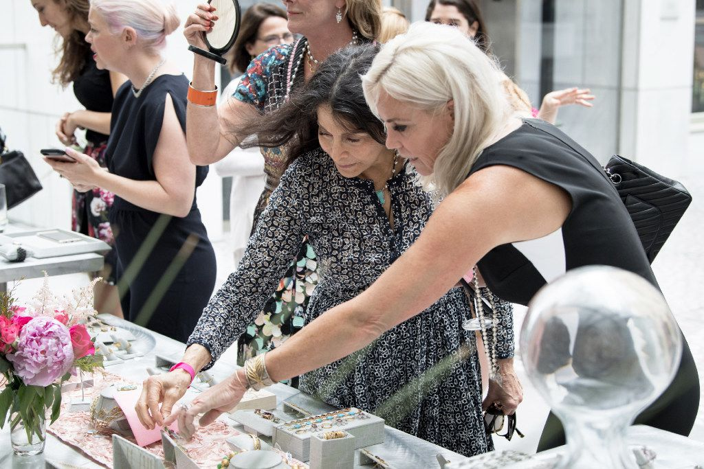 Jewelry designer Cathy Waterman shows off her collection to Dallas collector Lynne Palmeiro at a trunk show luncheon at the Joule Hotel on May 10.
